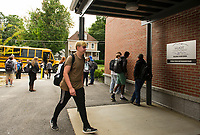Huot Technical Center students arrive for classes on Thursday morning.   Programs are available for students from Laconia, Gilford, Belmont, Interlakes, Franklin and Winnisquam school districts.   (Karen Bobotas/for the Laconia Daily Sun)