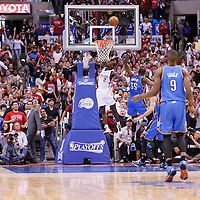 11 May 2014: Los Angeles Clippers guard Darren Collison (2) scores on a fast break over Oklahoma City Thunder forward Kevin Durant (35) during the Los Angeles Clippers 101-99 victory over the Oklahoma City Thunder, during Game Four of the Western Conference Semifinals of the NBA Playoffs, at the Staples Center, Los Angeles, California, USA.