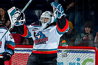 KELOWNA, BC - MARCH 6: Roman Basran #30 of the Kelowna Rockets throws his arms in the air to celebrate the win against the Seattle Thunderbirds at Prospera Place on March 6, 2020 in Kelowna, Canada. (Photo by Marissa Baecker/Shoot the Breeze)