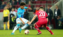 Reiss Nelson of Arsenal takes on Salih Ozcan of Cologne - Mandatory by-line: Robbie Stephenson/JMP - 23/11/2017 - FOOTBALL - RheinEnergieSTADION - Cologne,  - Cologne v Arsenal - UEFA Europa League Group H