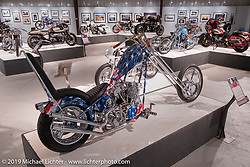 """Rick Fairless' Strokers Dallas' custom S&S 124"""" rigid chopper in the More Mettle - Motorcycles and Art That Never Quit exhibition in the Buffalo Chip Events Center Gallery during the Sturgis Motorcycle Rally. SD, USA. Wednesday, August 11, 2021. Photography ©2021 Michael Lichter."""