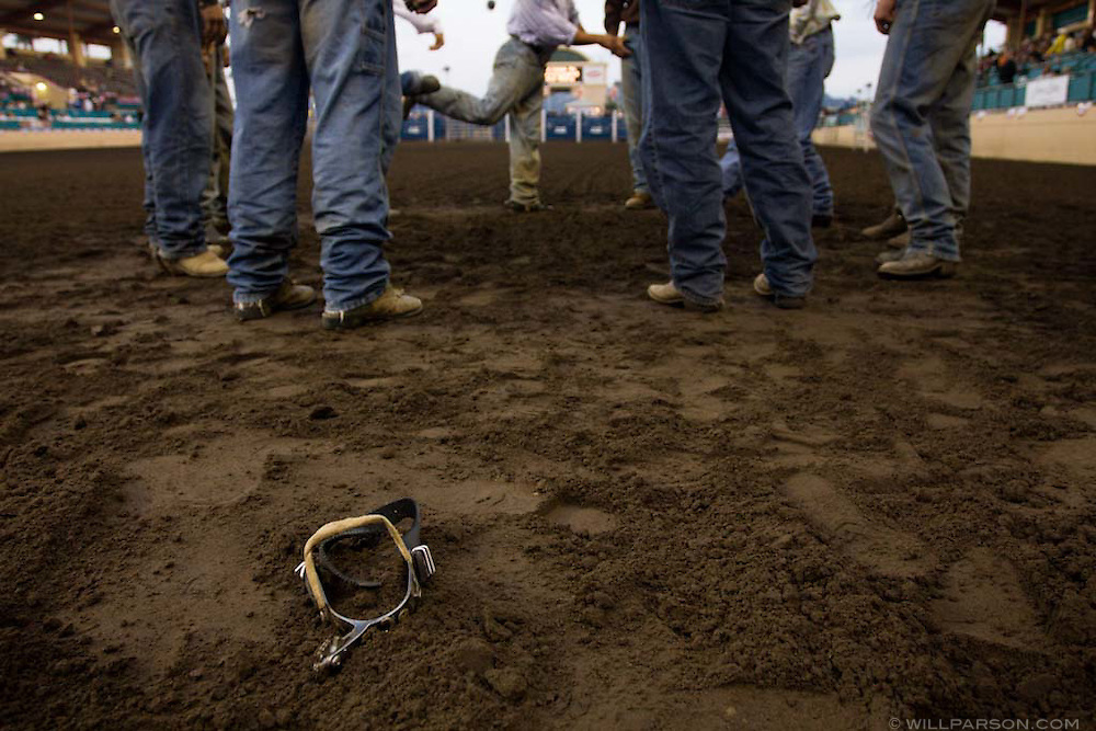 A group of cowboys warms up with a game of hackey-sack before the PBR rodeo at the Del Mar Fairgrounds in Del Mar, California on July 26th, 2008.