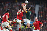 Lloyd Williams of Wales and Handre Pollard of South Africa jump for a high ball. Rugby World Cup 2015 quarter final match, South Africa v Wales at Twickenham Stadium in London, England  on Saturday 17th October 2015.<br /> pic by  John Patrick Fletcher, Andrew Orchard sports photography.