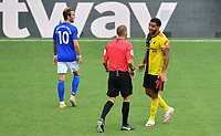 Football - 2019 / 2020 Premier League - Watford vs. Leicester City<br /> <br /> Watford's Troy Deeney in conversation with Referee Craig Pawson, at Vicarage Road.<br /> <br /> COLORSPORT/ASHLEY WESTERN