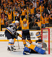 NASHVILLE, TN - MAY 02:  Jay Bouwmeester #19 of the St. Louis Blues watches Mike Fisher #12 of the Nashville Predators celebrate after a goal against goalie Jake Allen #34 during the third period of Game Four of the Western Conference Second Round during the 2017 NHL Stanley Cup Playoffs at Bridgestone Arena on May 2, 2017 in Nashville, Tennessee.  (Photo by Frederick Breedon/Getty Images)