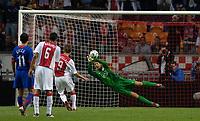 Photo: Daniel Hambury.<br />Ajax v Manchester United. Amsterdam Tournament. <br />05/08/2006.<br />Ajax's Klass Jan Huntelaar sees his penalty saved by  Manchester's Edwin van der Sar.