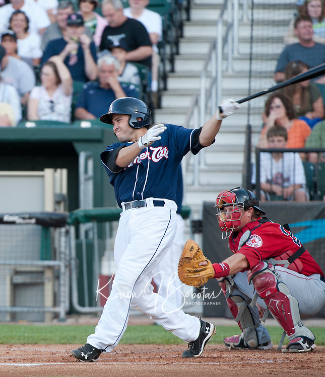 New Hampshire Fisher Cats catcher Travis D'Arnaud connects for a hit during Saturday's game with the Portland Sea Dogs.  (Karen Bobotas/for the Concord Monitor)
