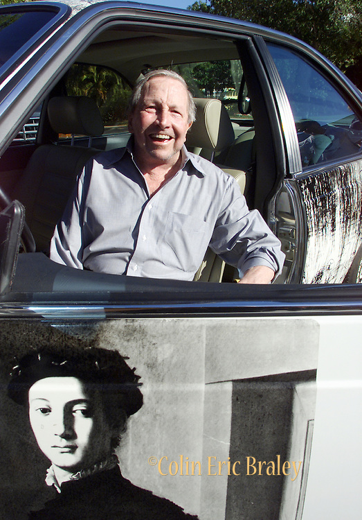 """American pop culture artist Robert Rauschenberg sits in one of his """"Beamer"""" collage cars at an art gallery in Naples, Florida in this 2002 file photo. The 82-year-old died Monday, May 12, 2008, of heart failure according to Jennifer Joy, his representative at PaceWildenstein gallery in New York. Rauschenberg's incorporation of everyday items, both common place and the odd in his artwork earned him the reputation as a pioneering pop artist, gaining fame in the 1950's. Photo by Colin Braley."""