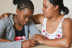 Mother comforting teenage girl. Cleared for Mental Health issues.