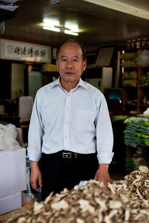Daegu/South Korea, Republic Korea, KOR, 16.10.2009: Owner of a traditional herbal medicine shop at the herbal market area in Daegu.
