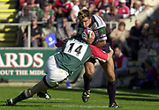 Leicester, 13th September 2003, Zurich Premiership Rugby,  Welford Road, <br /> [Mandatory Credit; Peter Spurrier/Intersport Images]<br /> Zurich Premiership Rugby - Leicester Tigers v London Irish.<br /> Exiles wing, Justin Bishop, is tackled by Ollie Smith