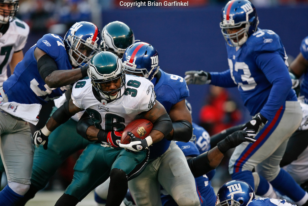 11 Jan 2009: Philadelphia Eagles running back Brian Westbrook #36 runs the ball with heavy coverage during the game against the New York Giants on January 11th, 2009.  The  Eagles won 23-11 at Giants Stadium in East Rutherford, New Jersey.