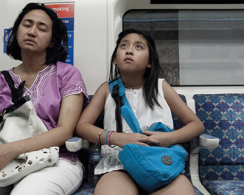 Mother and daughter travelling on the London Underground Network