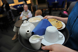 Tea tray in a busy cafe in a shopping centre