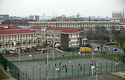 Pupils play football in the recreation area at St Paul's Way Trust School, Bow, East London. Fewer than 10% of pupils speak English as their first language and 85% are of Bangladeshi origin at the school.