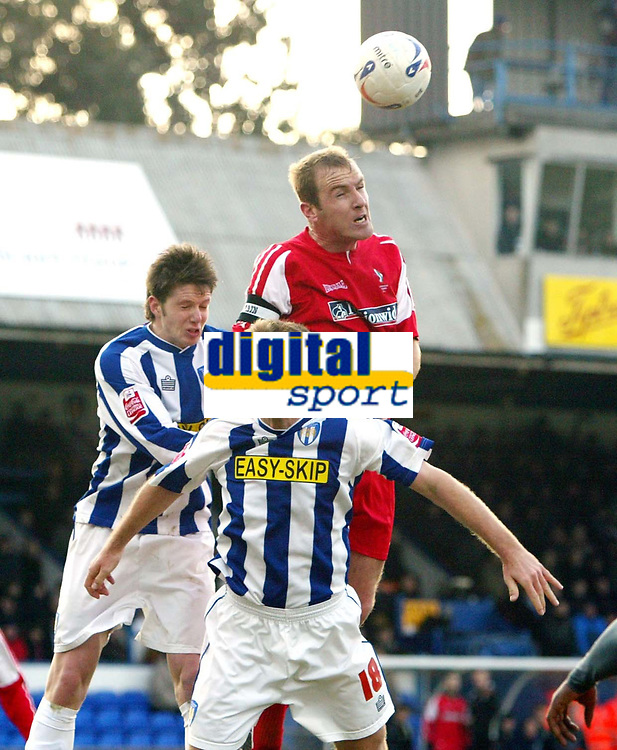 Photo: Chris Ratcliffe.<br />Colchester United v Swindon Town. Coca Cola League 1. 18/03/2006.<br />Sean O'Hanlon (R) of Swindon goes up for a header with Greg Halford (L) and Liam Chilvers (front) of Colchester