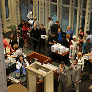 Couples line up for the security check to receive same sex marriage licenses in advance of now legal wedding ceremonies which can begin at 12:01 a.m., when Florida's ban on same-sex marriage ends,at the Osceola County Courthouse in Kissimmee, Florida on Tuesday, January 6, 2014.  (AP Photo/Alex Menendez)