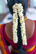 Jasmine flowers in the hair of a shop assistant in the Oh Lala boutique in Pondicherry, India<br /> Pondicherry now Puducherry is a Union Territory of India and was a French territory until 1954 legally on 16 August 1962. The French Quarter of the town retains a strong French influence in terms of architecture and culture.