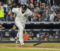 October 18, 2017 - Bronx, NY, USA - The New York Yankees' Gary Sanchez hits an RBI single in the fifth inning against the Houston Astros in Game 5 of the American League Championship Series at Yankee Stadium in New York on Wednesday, Oct. 18, 2017. The Yankees won, 5-0, for a 3-2 series lead. (Credit Image: © Howard Simmons/TNS via ZUMA Wire)