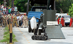 (170818) -- GUWAHATI, INDIA, Aug. 18, 2017 (xinhua) -- A bomb disposal robot carries a bag containing improvised explosive device (IDE) outside a railway station in Guwahati, north eastern Indian state of Assam on August 18, 2017. A potential accident was averted on Friday by local police after an IED packed in bag, which was booked by Rail Mail Service, was detected at the station, said local official. (Xinhua/Stringer) (lrz) (Photo by Xinhua/Sipa USA)