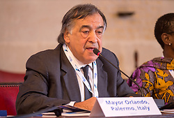 © Licensed to London News Pictures. 22/10/2018. Bristol, UK. Global Parliament of Mayors Annual Summit, 21-23 October 2018, at Bristol City Hall. Picture of LEOLUCA ORLANDO, Mayor of Palermo, Sicily, Italy, taking part in the plenary session on harnessing the power of migration. The Global Parliament of Mayors 2018 is the biggest and most ambitious Annual Summit to date. GPM Bristol 2018 will host up to 100 global mayors for an action-focused summit that addresses some of the biggest challenges facing today's world cities. GPM Bristol 2018's theme, Empowering Cities as Drivers of Change, will focus minds on global governance and the urgent need for the influence, expertise and leadership of cities to be felt as international policy is shaped. GPM Bristol 2018 will provide mayoral delegates with a global network of connections and a space to develop the collective city voice necessary to drive positive change. The programme will engage participants in decision-making, with panels, debate and voting on priority issues including migration and inclusion, urban security and health, and is a unique chance to influence decisions on the most pressing issues of our time. Photo credit: Simon Chapman/LNP