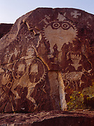 Large shield-bering figures, petroglyphs of the Rio Grande Style, Galisteo Basin, New Mexico.