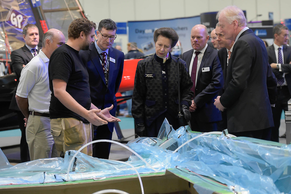 Here she watches as students build a hull with resin. HRH Princess Anne attend the show with her husband.  They make a tour of the show which includes awarding the Yachtmaster of the Year award, on the RYA stand, as well as meeting Sir Ben Ainslie, on his BAR stand. The CWM FX London Boat Show, taking place 09-18 January 2015 at the ExCel Centre, Docklands, London. 09 Jan 2015.
