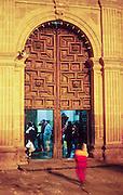 16 JANUARY 2002, GUANAJUATO, GUANAJUATO, MEXICO: People walk into the Basilica of Our Lady of Guanajuato during an evening mass in the city of Gunajuato, state of Guanajuato, Mexico, Jan. 16, 2002.  .PHOTO BY JACK KURTZ