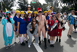 A naked man poses with other participants at the 107th running of the Bay to Breakers, Sunday, May 20, 2018, in San Francisco. (Photo by D. Ross Cameron)