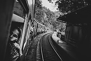 A passenger train stops briefly at  a small station somewhere between Colombo and Kandy, Sri Lanka.<br /><br />(April 1, 2017)