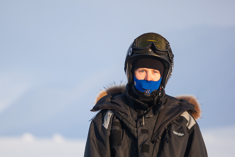 UNIS student Alistair Everett pensive on Rabotbreen, Svalbard, on a class field trip by snowmobile to Tunabreen.