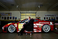 Giuseppe Risi, president of Risi Competizione, sits next to a Ferrari 430 GT raced in the 2008 and 2009 season