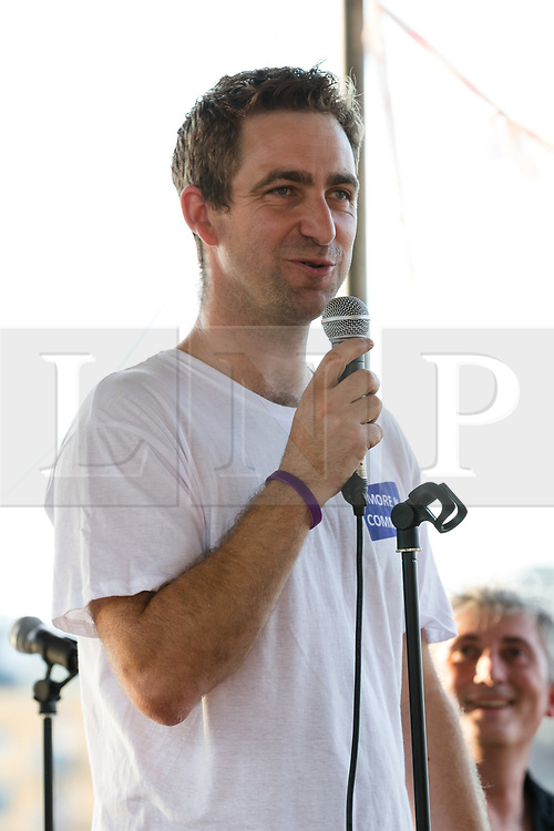 © Licensed to London News Pictures. 18/06/2017. LONDON, UK.  Brendan Cox, husband of murdered MP, Jo Cox speaks and pays tribute to Jo Cox at The Great Get Together at Tower Bridge Moorings in London last night, 17th June 2017. Friends and residents from Hermitage Moornings, where Jo Cox lived on a houseboat with her husband and two children visited residents and friends at nearby Tower Bridge moorings on the River Thames. Photo credit: Vickie Flores/LNP