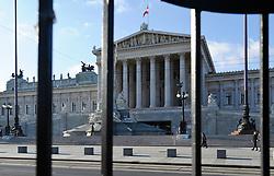 THEMENBILD - Wiener Eistraum, Eislaufen am Rathausplatz in Wien, das Bild wurde am 25. Jaenner 2012 aufgebommen, im Bild Parlament hinter Gittern, AUT, EXPA Pictures © 2012, PhotoCredit: EXPA/ M. Gruber