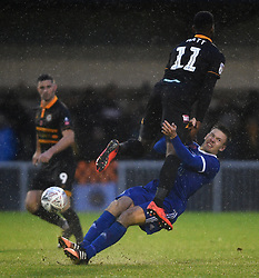 Metropolitan Police's Louis Birch is fouled by Newport County's Jamille Matt during the Emirates FA Cup first round match at Imber Court, London.