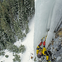 """ICE CLIMBING, Alex Lowe repeats his first ascent of """"Come & Get It,"""" a """"mixed climb"""" up a hanging ice needle in Hyalite Canyon, near Bozeman, Montana."""