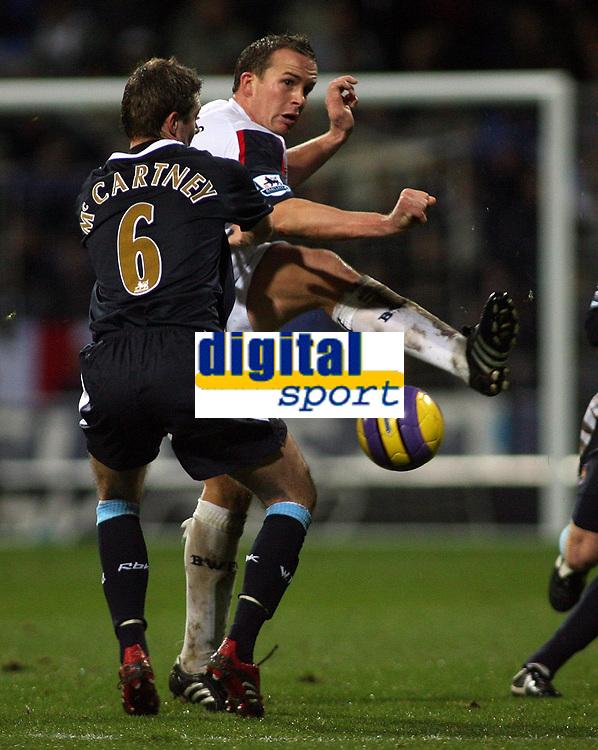 Photo: Paul Thomas.<br /> Bolton Wanderers v West Ham United. The Barclays Premiership. 09/12/2006.<br /> <br /> Goal scorer Kevin Davies of Boton passes it around George McCartney (6) of West Ham.