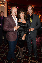 Left to right, GRAHAM NORTON, JOAN COLLINS and JULIAN CLARY at a party to celebrate the publication of 'Passion for Life' by Joan Collins held at No41 The Westbury Hotel, Mayfair, London on21st October 2013.
