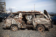 A car which was swept away by the tsunami was raised from the ocean, which is covered with  seashells in Ishinomaki city.