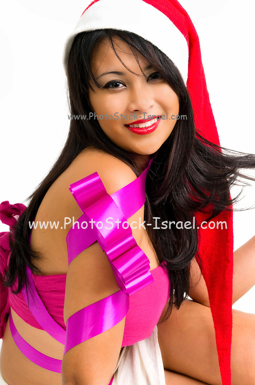 Gift wrapped young Asian woman with Santa hat