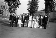 """16/09/1967<br /> 09/16/1967<br /> 16 September 1967<br /> Wedding of Mr Francis W. Moloney, 28 The Stiles Road, Clontarf and Ms Antoinette O'Carroll, """"Melrose"""", Leinster Road, Rathmines at Our Lady of Refuge Church, Rathmines, with reception in Colamore Hotel, Coliemore Road, Dalkey. Image shows (l-r): unnamed gentleman; Mr Dudley O'Carroll; rs Patrick Moloney; Bestman, Michael Power; the Bride and Groom; Bridesmaid, flower girl; Matron of Honour Gladys McGloughlin; Mrs Dudley O'Carroll and Mr Patrick Moloney."""