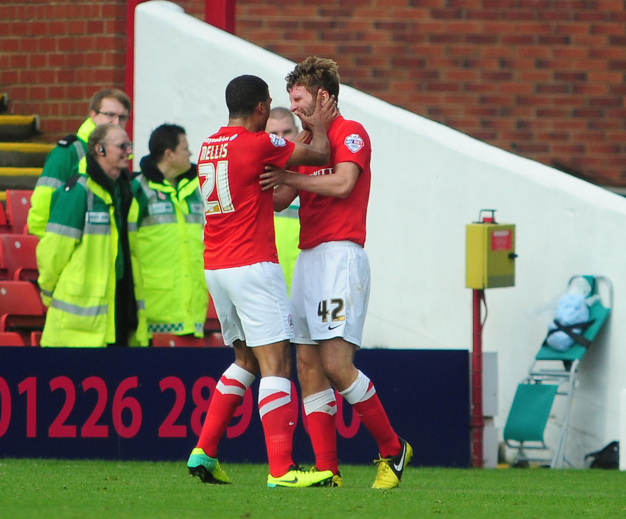 Barnsley's Patrick McCourt, right, celebrates scoring his sides first goal with team-mate Jacob Mellis<br /> <br /> Photo by Chris Vaughan/CameraSport<br /> <br /> Football - The Football League Sky Bet Championship - Barnsley v Middlesbrough - Saturday 19th October 2013 - Oakwell Stadium - Barnsley<br /> <br /> © CameraSport - 43 Linden Ave. Countesthorpe. Leicester. England. LE8 5PG - Tel: +44 (0) 116 277 4147 - admin@camerasport.com - www.camerasport.com