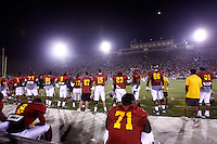22 August 2007: Cardinal team players on the sidelines under the stadium lights during USC Trojans NCAA Pac-10 college football team fall intrasquad scrimmage at the LA Memorial Coliseum on Wednesday night infront of 18,000 fans who attended for free.
