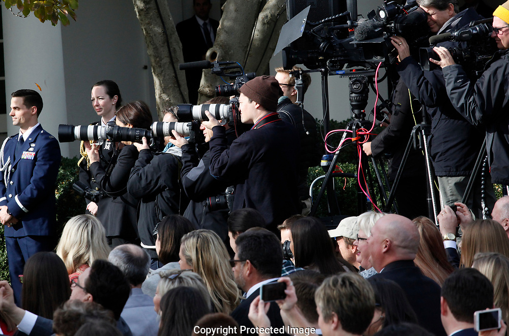 Photographers cover President Donald Trump and First Lady  Melania Trump and First son Baron Trump participate in the  pardon of the Thanksgiving turkey in the rose Garden on November 21,2017<br /> Photo by Dennis Brack