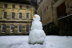 Edinburgh, Scotland, UK. 21 January 2020. Scenes taken between 4am and 5am in Edinburgh city centre after overnight snow fall. Pic  snowman in Parliament Square.  Iain Masterton/Alamy Live News
