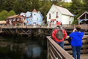 North America,USA,Alaska,Southeast,Ketchikan,man and woman exploring historic Creek Street