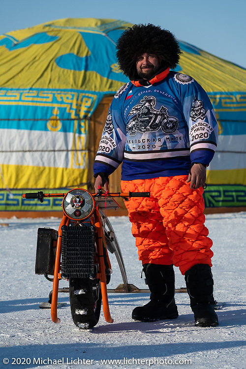 Moscow motorcycle mechanic Alexander Pikalo (he rode a motorcycle 10,000 km from Moscow through Siberia in winter to be here) with his unimotocycle ready to race in the Baikal Mile Ice Speed Festival. Maksimiha, Siberia, Russia. Friday, February 28, 2020. Photography ©2020 Michael Lichter.