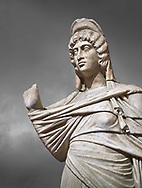 Roman statue of Julia Domina . Marble. Perge. 2nd century AD. Inv no 3268. Antalya Archaeology Museum; Turkey.  Against a grey background .<br /> <br /> If you prefer to buy from our ALAMY STOCK LIBRARY page at https://www.alamy.com/portfolio/paul-williams-funkystock/greco-roman-sculptures.html . Type -    Antalya     - into LOWER SEARCH WITHIN GALLERY box - Refine search by adding a subject, place, background colour, museum etc.<br /> <br /> Visit our ROMAN WORLD PHOTO COLLECTIONS for more photos to download or buy as wall art prints https://funkystock.photoshelter.com/gallery-collection/The-Romans-Art-Artefacts-Antiquities-Historic-Sites-Pictures-Images/C0000r2uLJJo9_s0