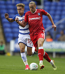 Gillingham's Tom Eaves (right) and Reading's Sam Smith battle for the ball during the Carabao Cup, first round match at the Madejski Stadium, Reading.