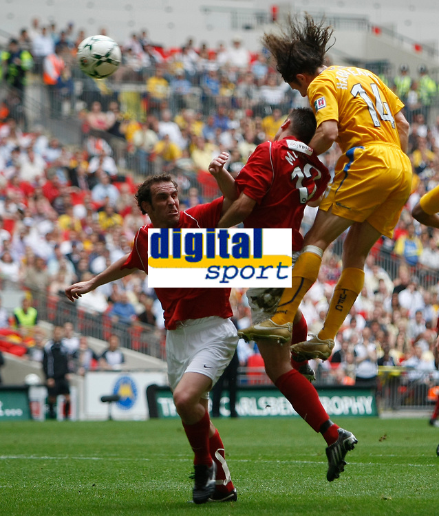 Photo: Steve Bond/Richard Lane Photography. <br />Ebbsfleet United v Torquay United. The FA Carlsberg Trophy Final. 10/05/2008. Chris Hargreaves (R) heads for goal above Luke Moore (C)